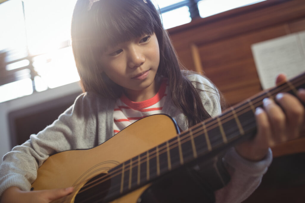 Student practicing her guitar