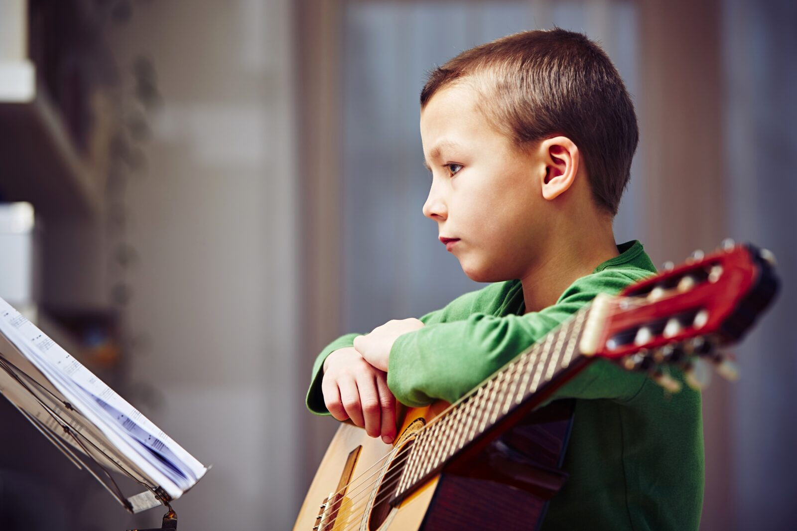 Boy studying his music