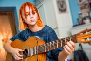Student with Guitar